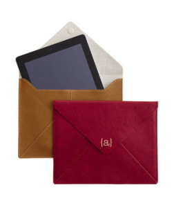 Monogrammed iPad Case A very traditional way to protect your tech-obsessed pal's latest gizmo. Add a monogram for an extra personal touch.