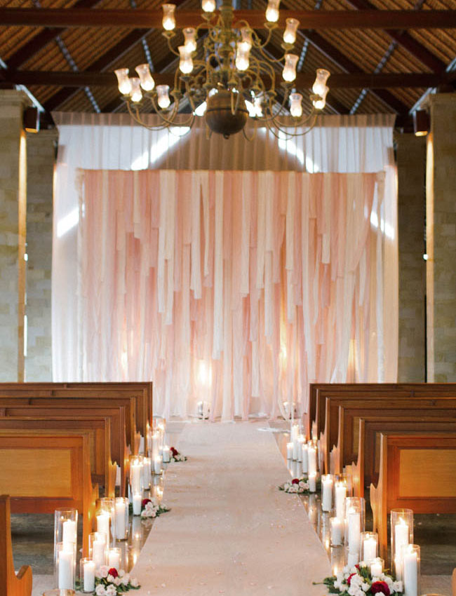 This ribbon backdrop + aisle of candles was so romantic from this Bali wedding