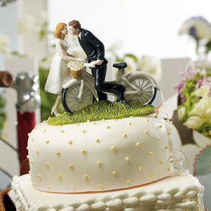 """""""A KISS ABOVE"""" BICYCLE BRIDE AND GROOM COUPLE FIGURINE"""