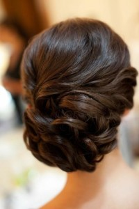 Sleek wedding wavy / curly bun / updo. Wedding hairstyles for long hair.