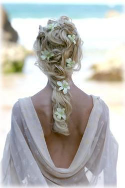 Stunning Wavy Wedding Hairstyle with Flowers