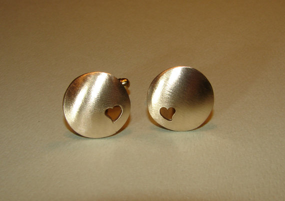 Cuff links handmade from bronze with heart cut outs