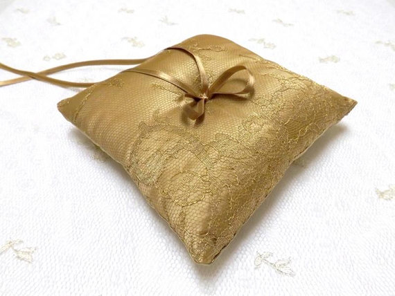 Wedding ring pillow. gold satin fabric and floral gold lace with gold satin ribbon.