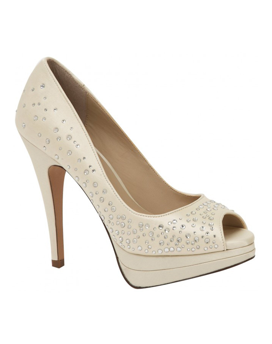 """""""Bring on the bling. These beautiful peep toe platform pumps feature sparkeling crystal accents all over to give a shimmering effect. The 1/2″ platform front makes the 4 1/2"""" heel comfortable and managable. Available in white and ivory.See how Brianna Leigh measures heel height."""