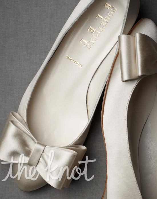 Ivory or French blue flats feature satin-wrapped heel and bow detail.
