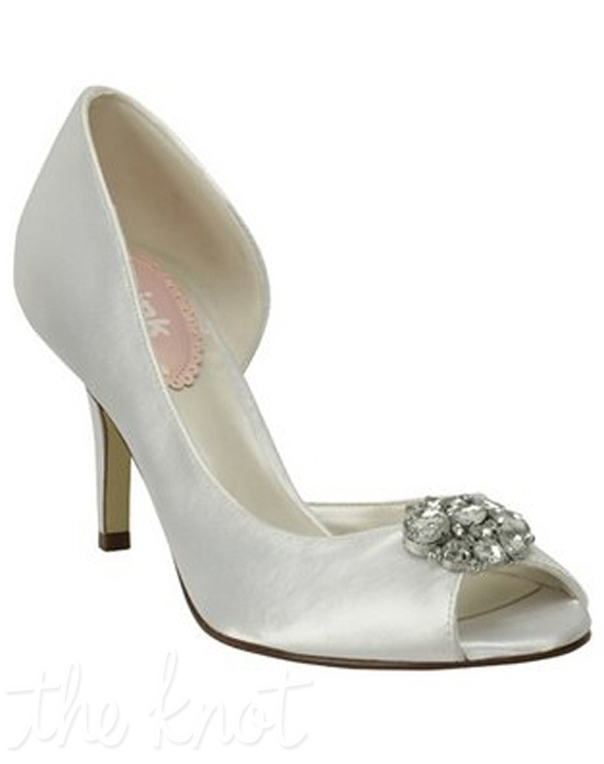 White or ivory satin pump features crystal brooch. White is dyeable.