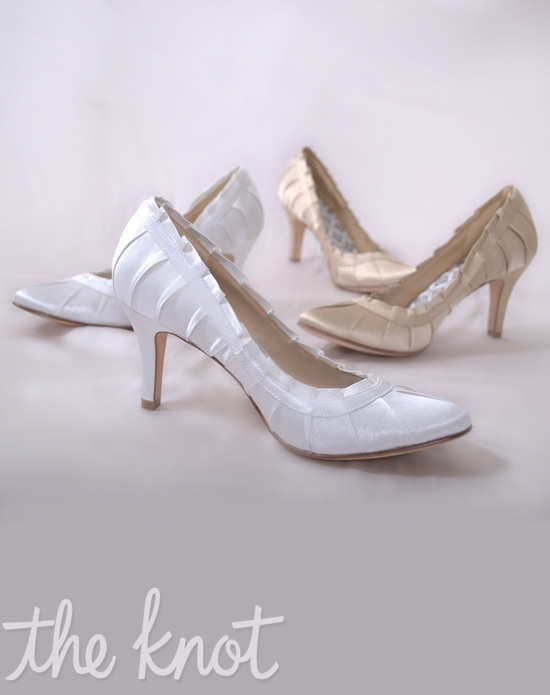 Pleated silk satin pump features 3″ heel and ruffled edge. Gold or White