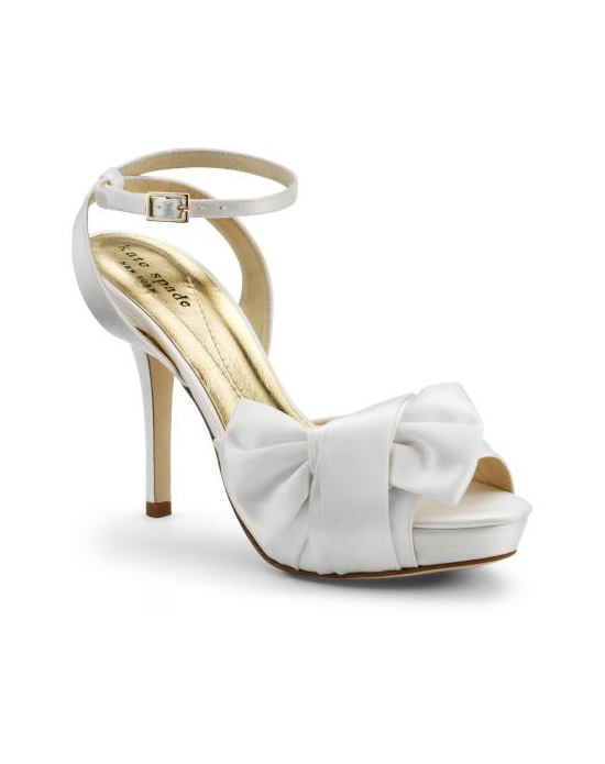 """From the slender heel and ankle strap to the wrapped bow at the toe, this shoe brings runway style to the wedding aisle. Made with luxurious white silk satin, the heel measures 4.5"". Available in a wide selection of sizes.See how Kate Spade measures heel height."