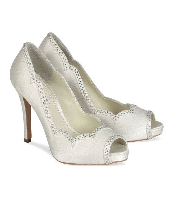 The Ivory Benjamin Adams Betty shoes are a gorgeous scalloped pump with rhinestone detailing. The classic peep toe design is updated with a beautiful feminine scalloped edging and light rhinestone detail for a touch of sparkle. Heel height measures 4″ with a covered 1/4″ platform front. Available in Ivory Duchess Silk.