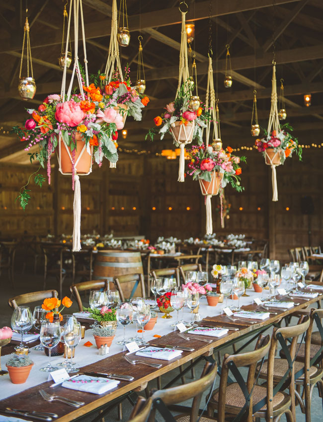 The peonies, poppies + more hanging with macrame were another favorite detail from this wedding designed by Events in the City + florals by Sweet Root Village