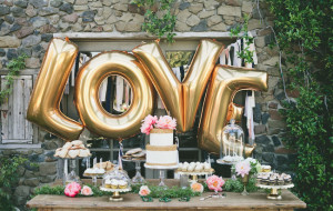 Giant gold balloons bring the perfect amount of whimsy into your wedding and loved the way they were used as part of the dessert table
