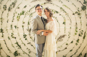 The kaleidoscope of flowers backdrop from this wedding designed by the bride