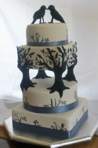 Unique birds and tree four tier wedding cake