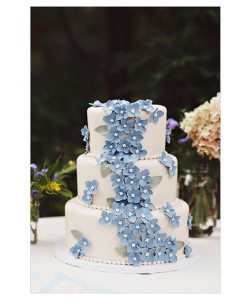 Something Blue A classic white fondant cake gets a touch of color from gum paste hydrangea petals cascading down one side.