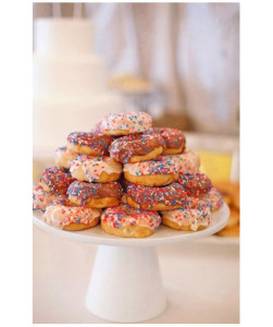 Doughnuts Doughnut lovers will rejoice when they set their eyes on these goodies frosted in your wedding colors and topped off with festive sprinkles. This ultra-indulgent snack will hit a high note.