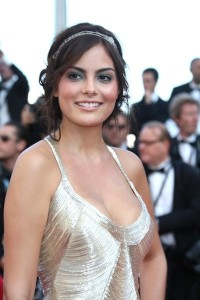Ximena Navarrete styles curled updo with a silver headband